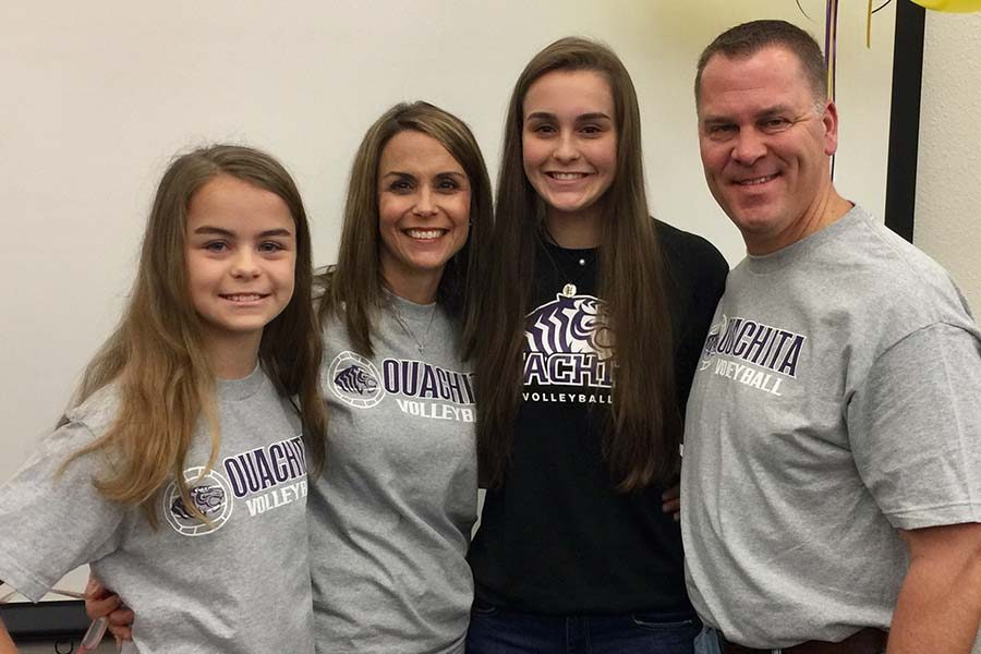 After+signing+with+Ouachita+Baptist+University+to+continue+her+volleyball+career%2C+senior+Madeline+Hogan+takes+a+family+picture+with+her+sister+Meren%2C+mom+Delight%2C+and+dad+Brian.%0A%0A%0A%0A
