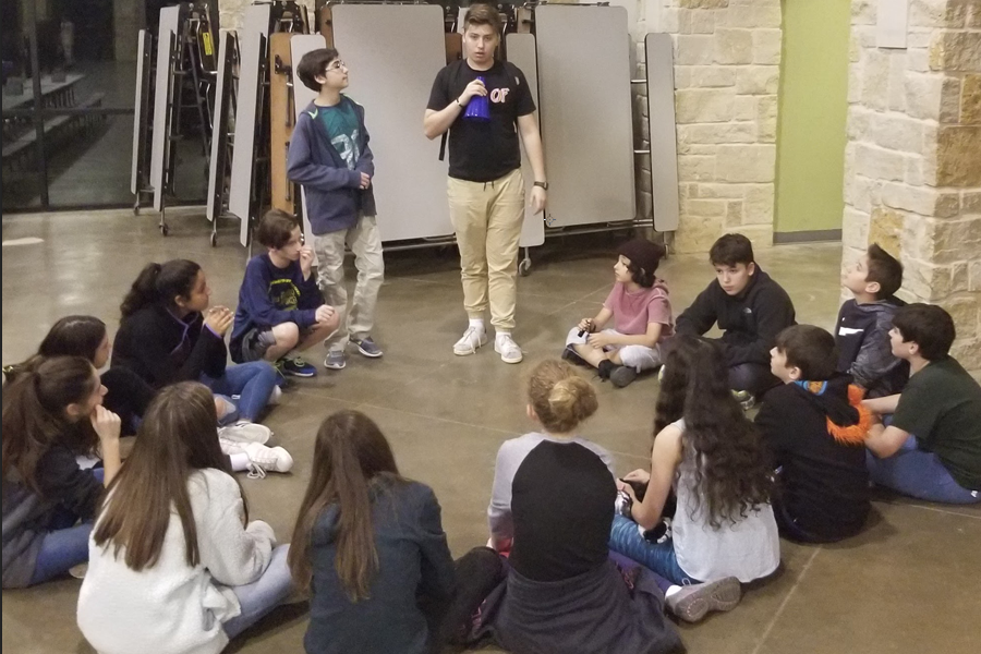 Taking part in the winter camp for the Israeli Scouts, sophomore, Roy Nitzan holds a discussion with the group of children he counsels.