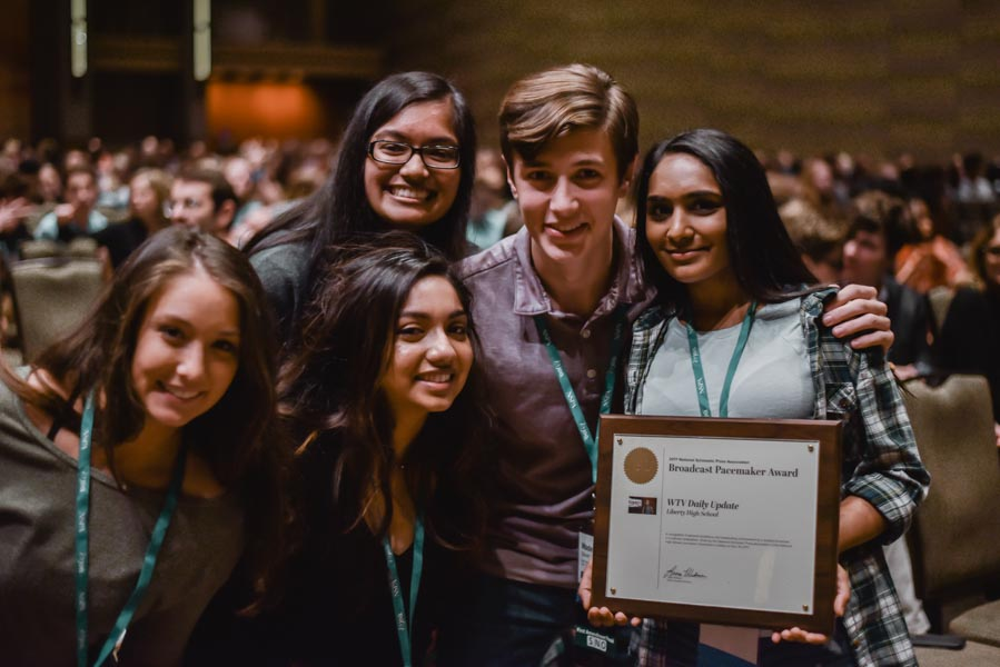 After being named a 2017 NSPA Broadcast Pacemaker winner, WTV Daily Update staff members Mady Daddario, Marisa Uddin, Divya Murali, Wade Glover, and Neha Perumalla pose for a picture in Dallas.