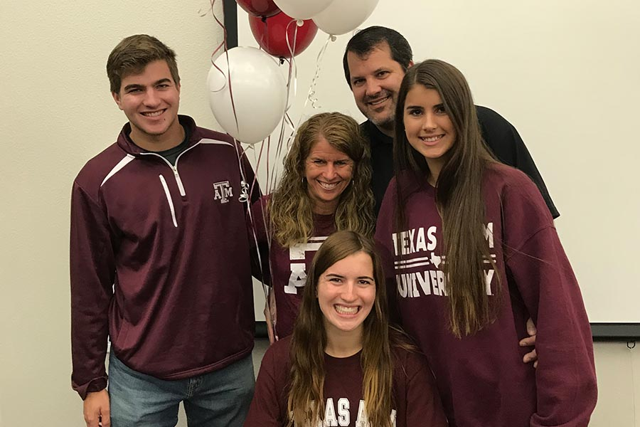 Surrounded by her brother John, mom Pam, dad Jack, and sister Kristen, senior Carrie Fish committed to Texas A&M on Wednesday as she will continue her cross country and track career in College Station starting in 2018.