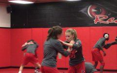 Girls' wrestling starts break with Arlington Invite