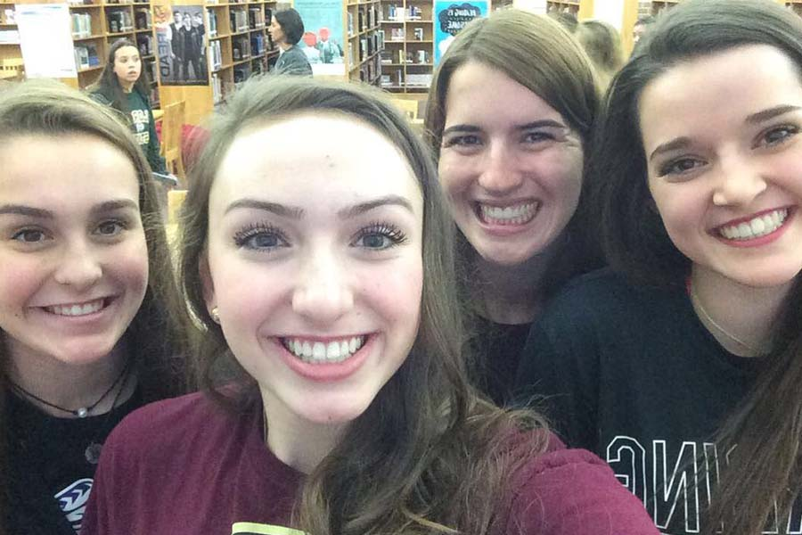 Madeline Hogan, Kate Blasingame, Carrie Fish, and Katelyn Burtch take a selfie at their Signing Day ceremony in the library on Wednesday, November 8, 2017.