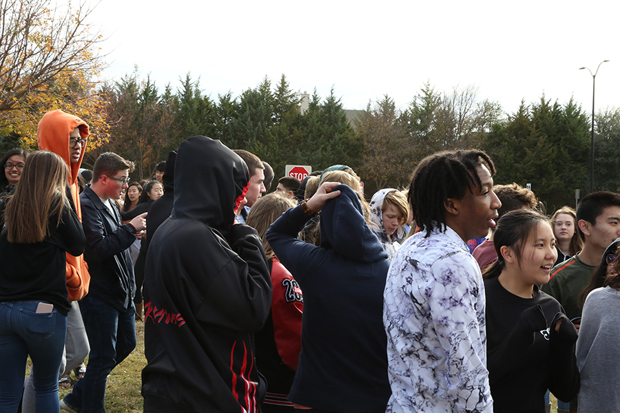 Students and staff were evacuated when a fire alarm sounded at approximately 2 p.m. on Thursday. Standing outside in temperatures in the low 40s, people did what they could to stay warm. The alarm sounded as a result of a water piper breaking in the auditorium.