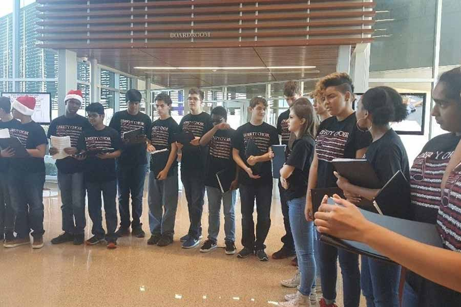 Performing at the Frisco ISD administration Tuesday afternoon, the school's varsity choir sang holiday songs for district administrators.