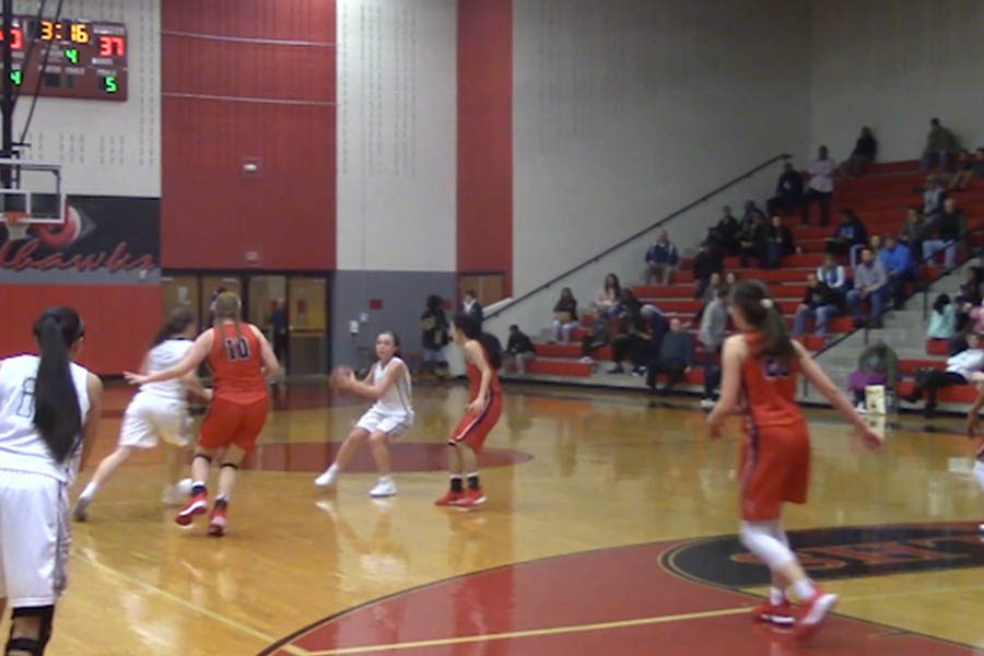 Working the ball on offense late in the 4th quarter against Centennial, the girls' basketball team pulled away with the win 42-38 on Tuesday, Dec. 13, 2017.