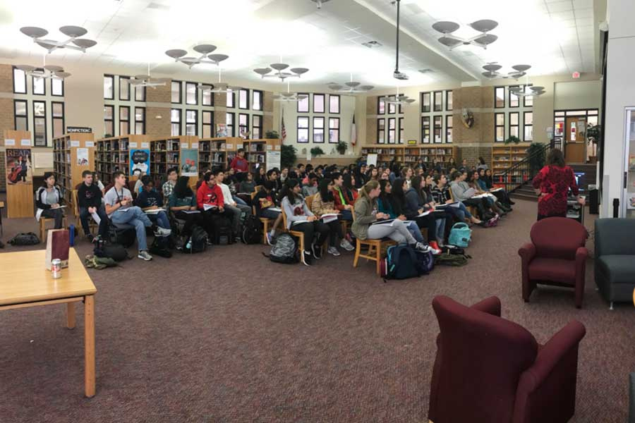 Humanities classes look on as author Gareth Hinds Skypes in as part of a lesson analyzing Hinds' art and his interpretation of the classic novel Beowulf.