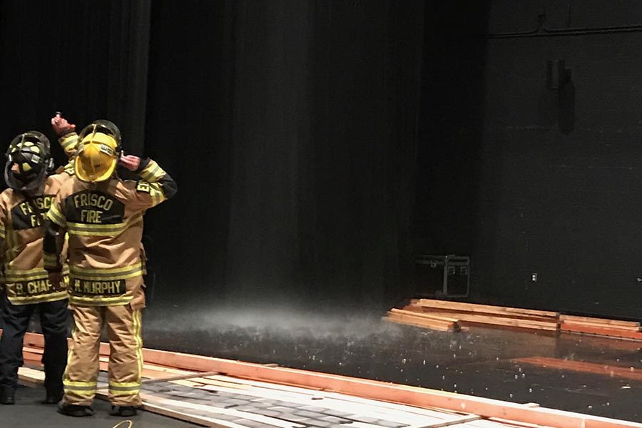 Rain showers down on stage after water pipe breaks in auditorium