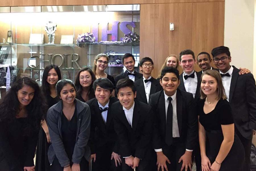Band and orchestra students admitted into the 2017 All-Region orchestras pose after performing in the concert.