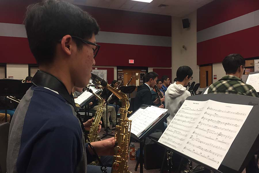 Practicing his instrument in band, saxophonist Eddie Chen has made yet another stride in his musical endeavor after being the grand prize winner of the Greater Dallas Youth Orchestra's competition.