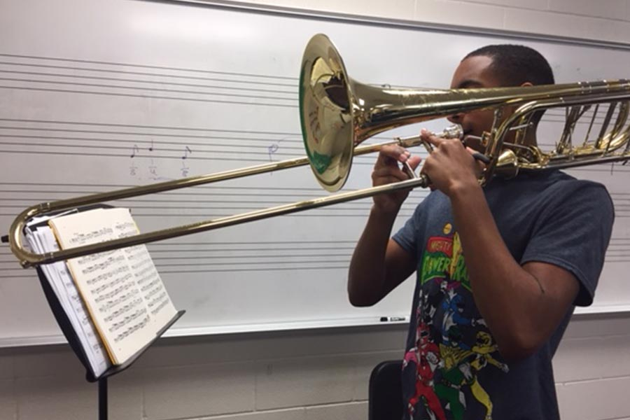 Despite being in the audition process for the first time, junior Josh Lee makes efforts throughout the school day to practice.