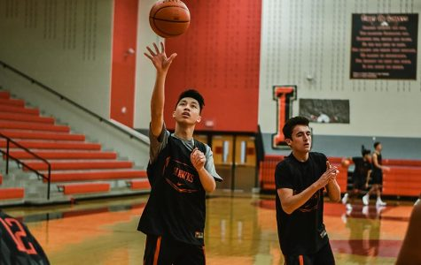 Playing basketball for six years, junior Kenny Cheung  said one of his proudest moments is