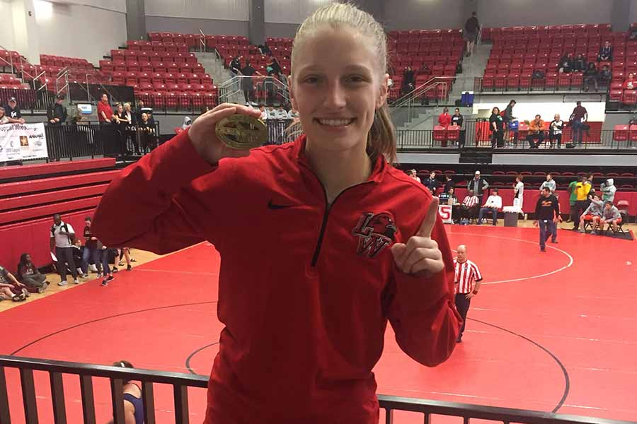 Holding one of her medals, junior Savannah West has four first place finishes this year and has her sight set on a run at state.