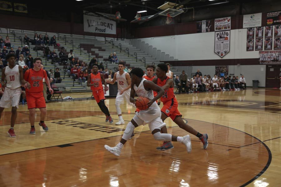 Driving to the basket in Tuesday's first round win over McKinney North, junior Zion Richardson lead the team in scoring with nine points. The team faces off against Mount Pleasant Friday in Rockwall at 7:30 p.m.