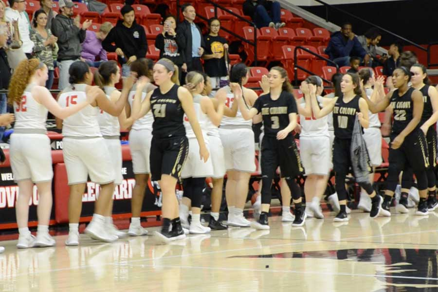 Walking off with a 45-42 win, the girls' basketball team shakes hands with players from The Colony High School after their third round playoff game on Tuesday, Feb. 20, 2018 at Lovejoy High School.
