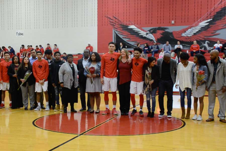 With+their+family+members+at+their+side%2C+seniors+James+Matthis%2C+Josh+Philips%2C+Zac+Watson%2C+Kendall+Brown%2C+and+Jadyn+Bennett+stand+at+half-court+during+senior+night+festivities+on+Tuesday%2C+Feb.+13%2C+2018.
