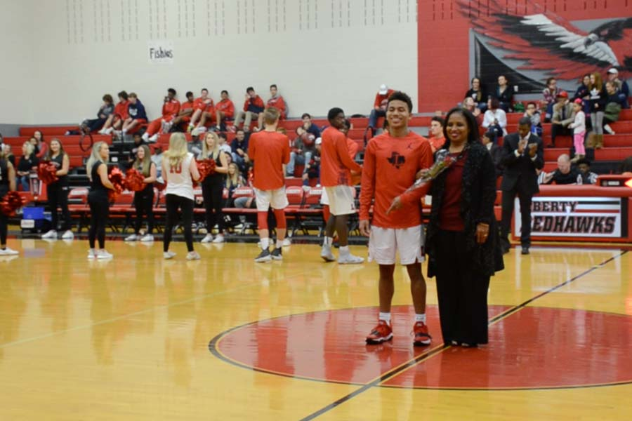 Senior+James+Matthis+and+all+other+senior+basketball+players+were+recognized+with+their+parents+prior+to+Tuesday%27s+game.+