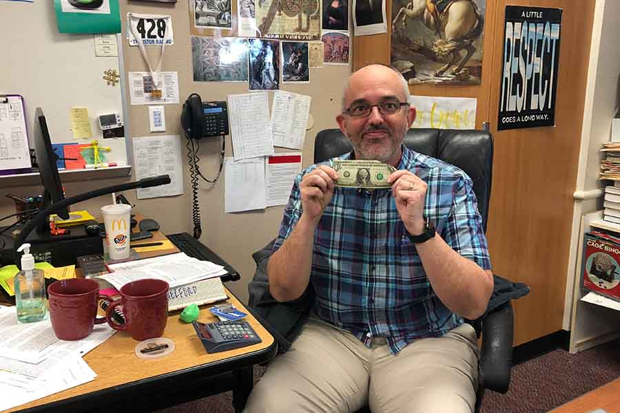 When teachers like AP World History teacher Jeff Crowe are called in to fill in due to a shortage of substitute teachers, they will now get paid $21.50 more than what he is holding in his hand.