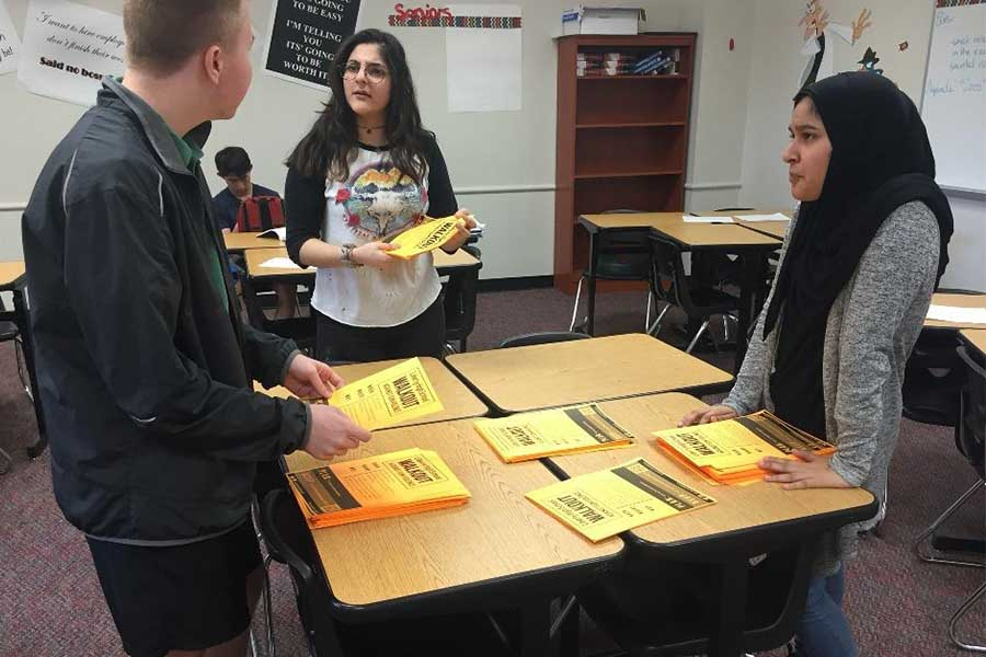 With stacks of flyers detailing the student led walkout scheduled for April 20, senior Parker Butler, along with juniors Dena Assad and Amina Syeda discuss their plan for handing out the flyers and raising awareness for the event.