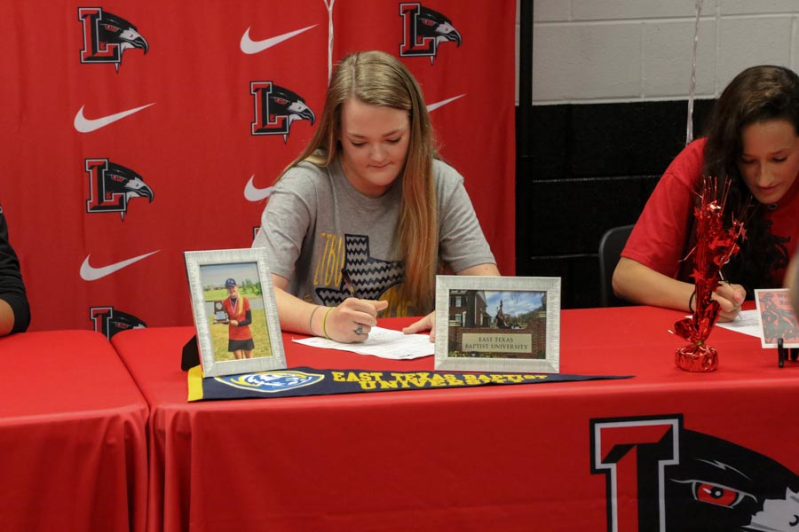 Madison McGarrh sported her East Texas Baptist University shirt as signed to play golf