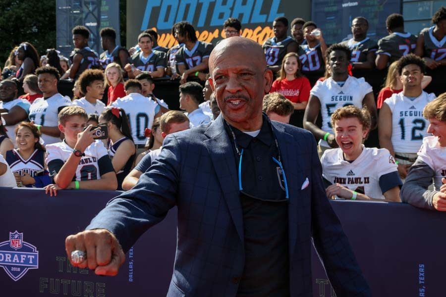 Former Dallas Cowboy, Drew Pearson shows off his Superbowl ring at the NFL Draft.