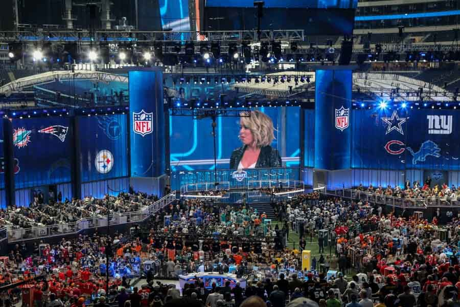 Taken before the start on the second day of the NFL Draft, teams stand in anticipation for their favorite college athletes.