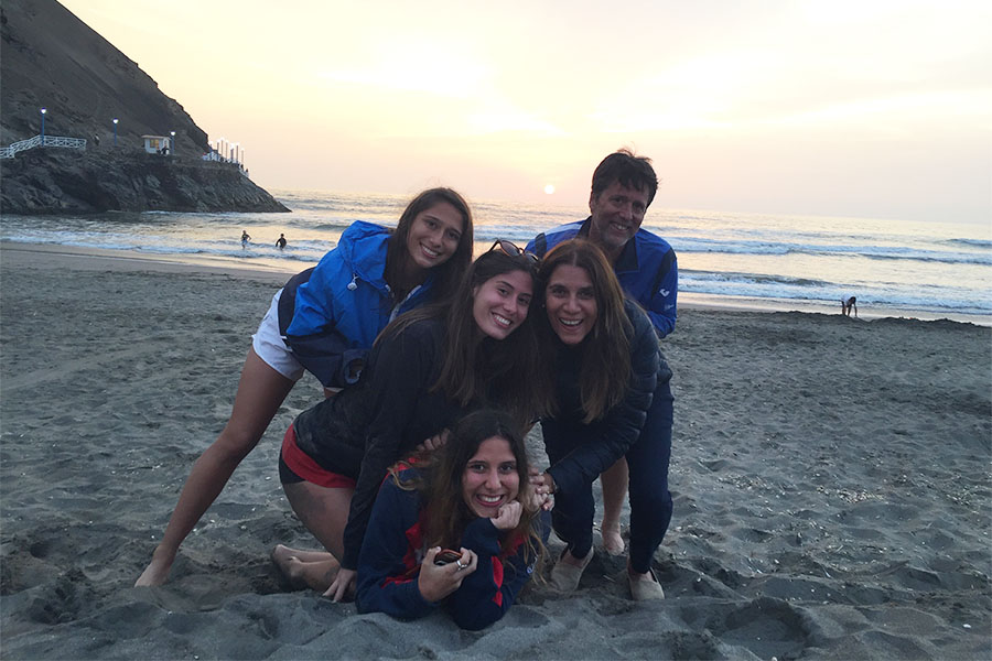 Thais Fernandez (left) pictured with her family at the beach in Peru.