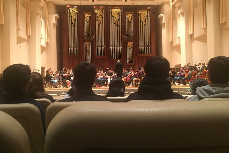 The band watches as the Baylor Orchestra rehearses for their performance.