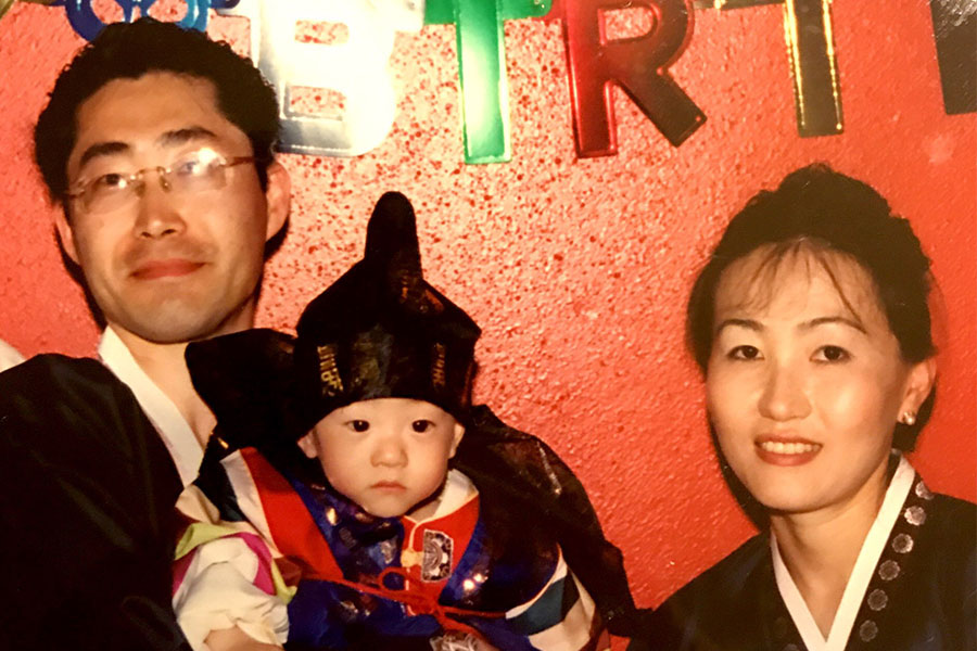 Bryan at age one pictured with his father Sokho and mother Young Ryu.