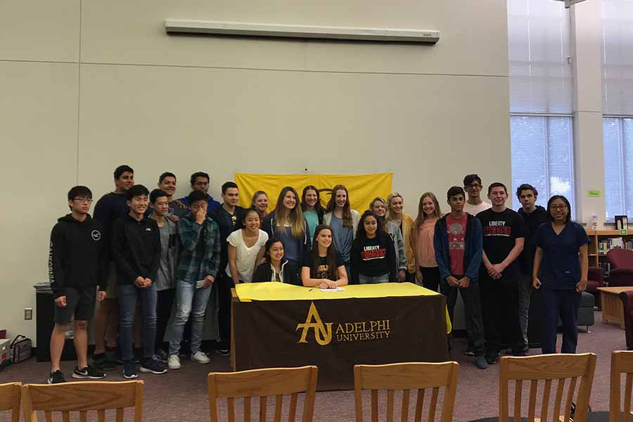 Senior Julia Cole reached a life long goal of continuing her swimming career after committing to Adelphi University Wednesday morning.