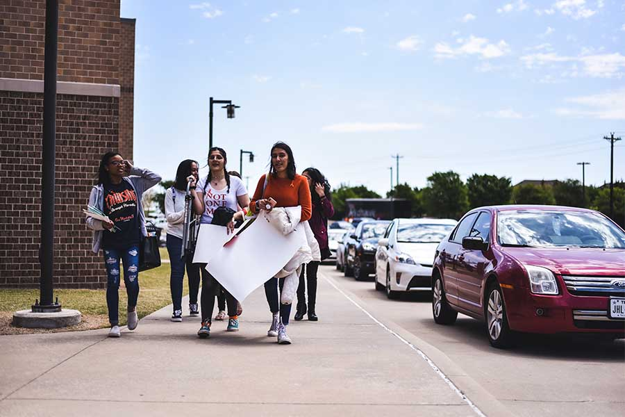 Students+walk+back+to+school+after+the+walkout.+