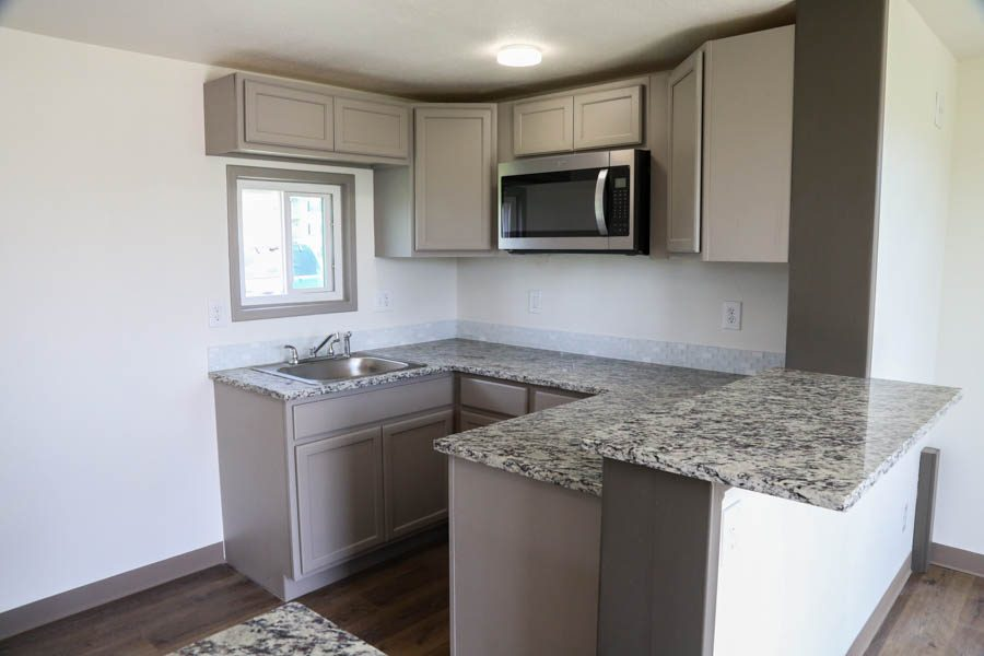 The prototype homes come with a kitchen outfitted with granite countertops, a microwave, sink, and mini fridge.