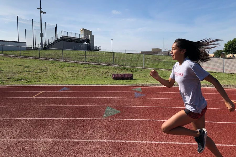 Sophomore+Suzanne+Ramirez+sprints+off+after+the+2018+school+track+season+for+summer+track+with+her+team%2C+Team+Quest.