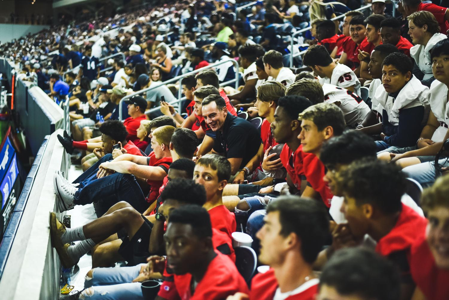 Filling+up+the+first+few+rows+on+the+home+sideline+of+the+Ford+Center%2C+the+Redhawks+football+team+takes+in+a+Cowboys+practice+on+Tuesday%2C+Aug.+21%2C+2018.+