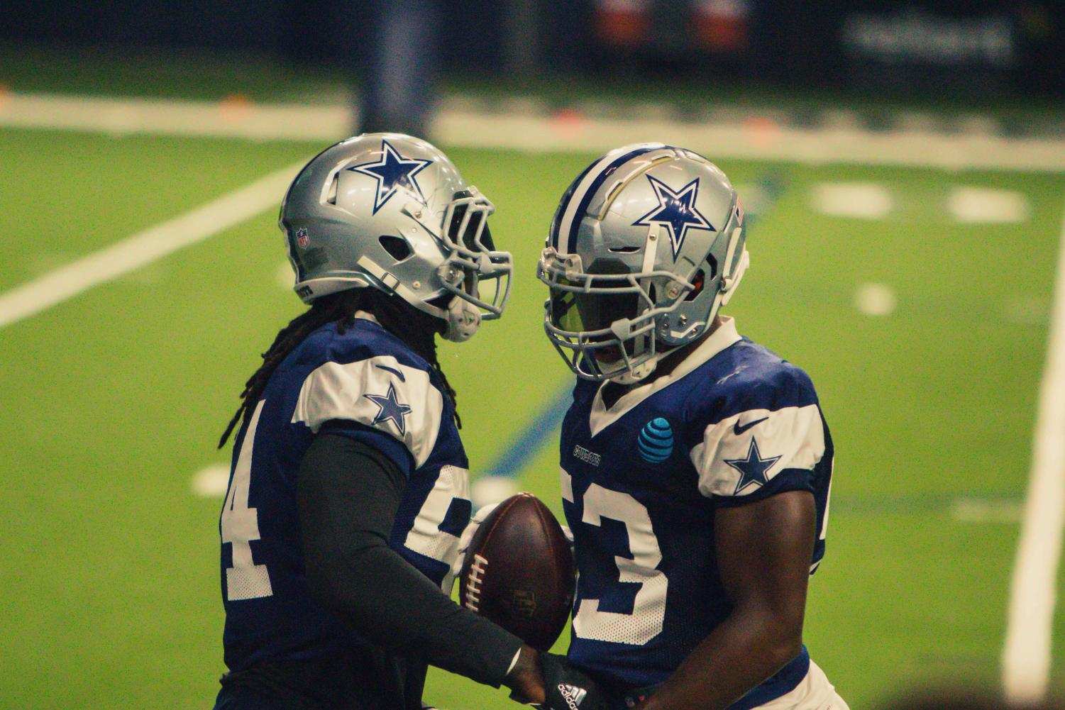 Linebacker+Jaylon+Smith+and+Tyree+Robinson+pass+the+ball+between+themselves+during+practice+at+the+Ford+Center+on+Tuesday%2C+Aug.+21%2C+2018.++