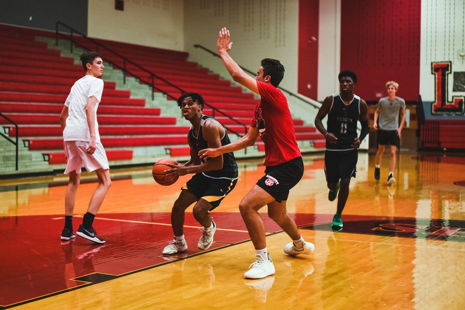 Boys' basketball gears up for the district season in their final non-district tournament on Thursday. Redhawks will kick off their district season next week on Tuesday against Frisco High School.