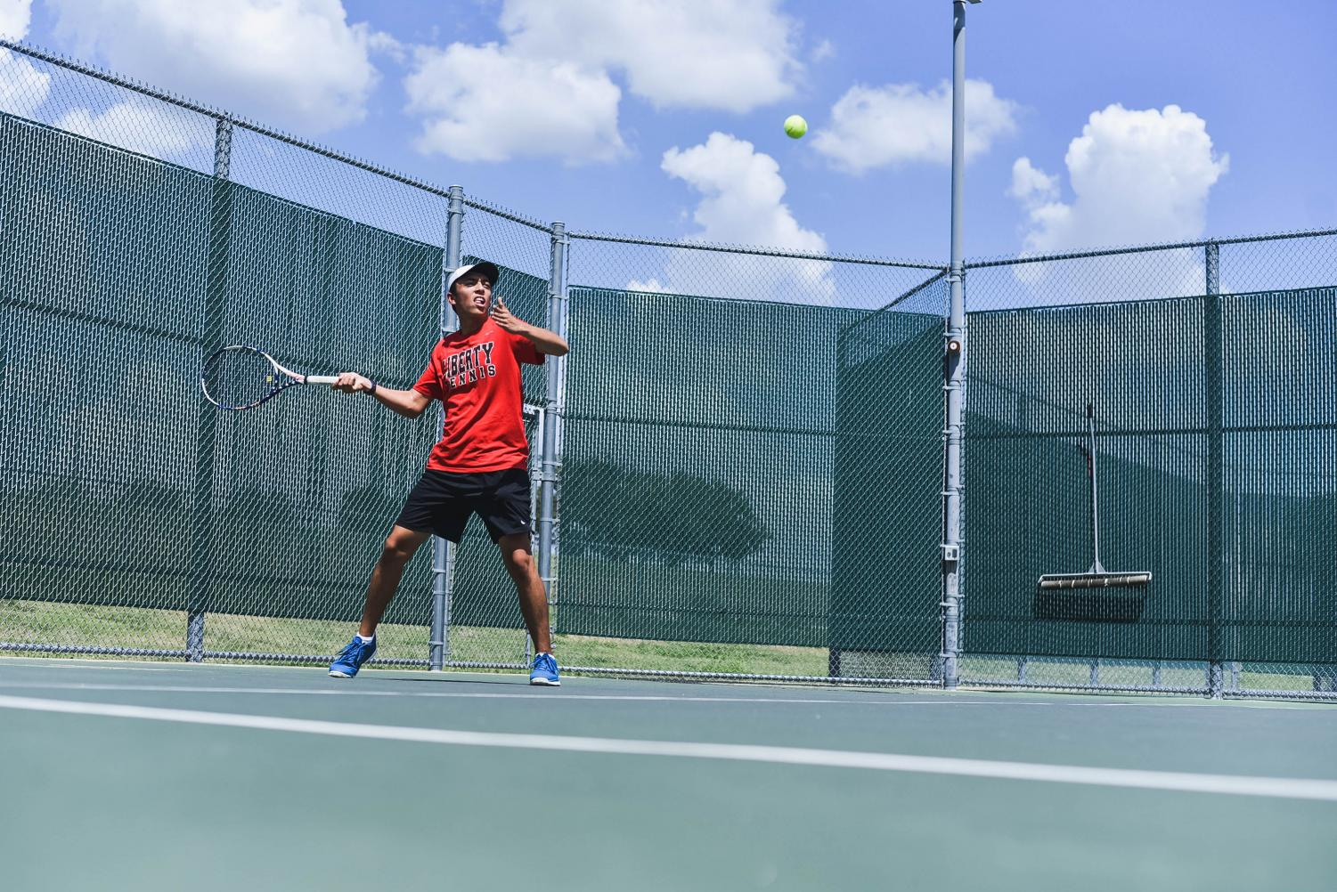 Readying himself to return the ball, senior Alex Lopez looks to hit a winning volley. After losing its last match, the Redhawks tennis team bounced back in the win column with Tuesday's 17-2 victory over Memorial High School.