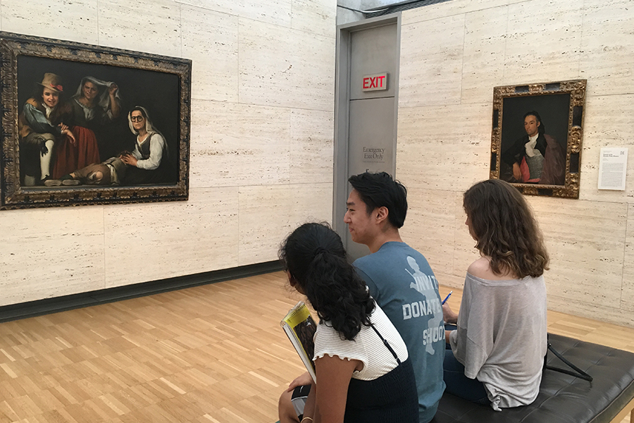 Students Shreya Volaboju, Jimmy Qian,and Melissa Rondinelli (left to right) observe art on an AP drawing field trip.