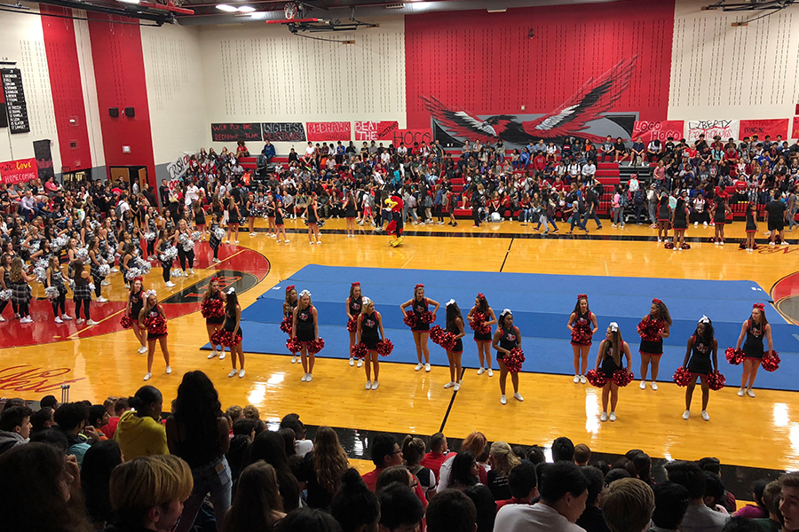 Cheerleaders take the floor at the start of Friday's homecoming pep rally. The indoor event was safe from the weather, but Friday's forecast could lead to a change in routine at the football game against Carrollton Creekview.
