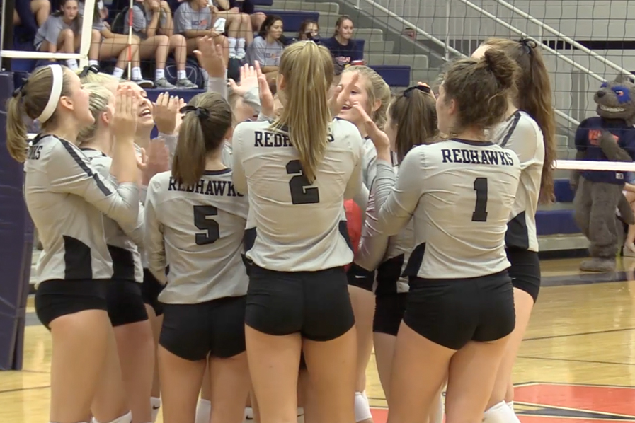 Redhawks hold first place in District 9-5A after completing their 11th win against the Titans at The Nest on Tuesday.