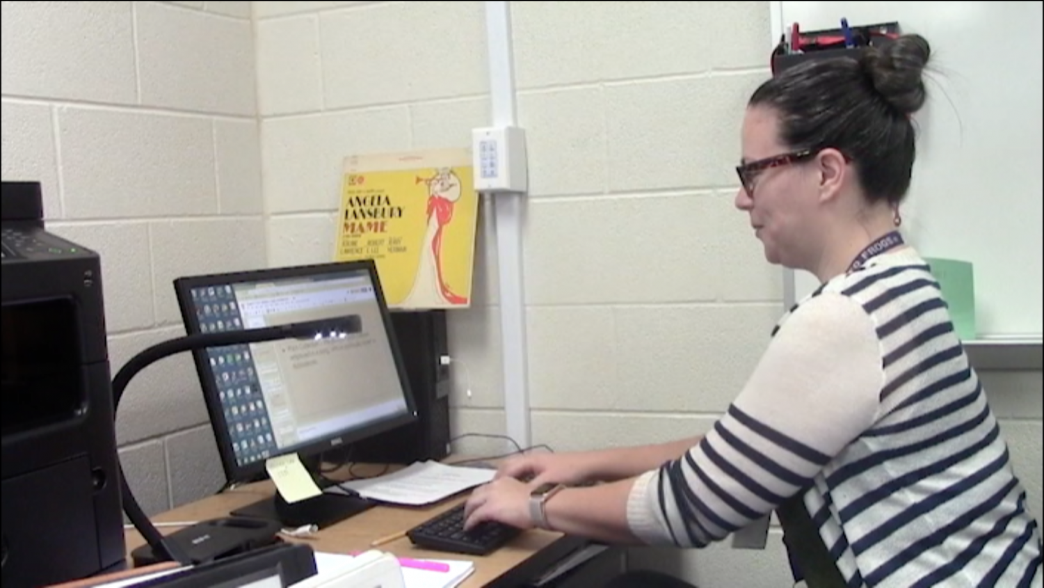 Choir director Toni Ugolini works at her computer as she adjusts to teaching at a high school level.