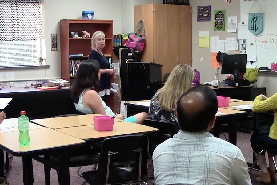 Parents+are+shown+in+math+teacher+Erica+Rogers%27+room+for+meet+the+teacher+night.