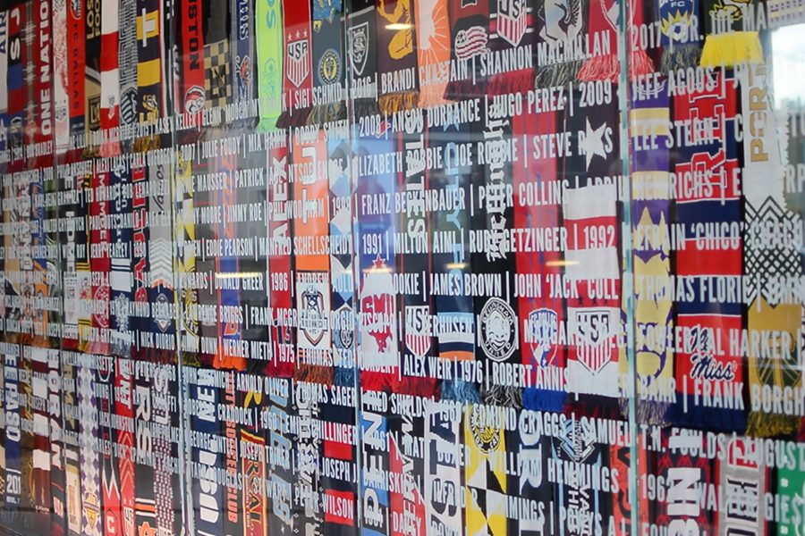 Names etched in glass cover the scarves of different soccer clubs, just one of dozens of different exhibits in the new National Soccer Hall of Fame at Toyota Stadium in Frisco.