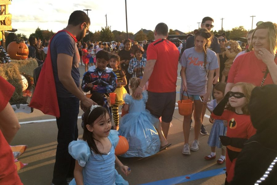 At the annual Trunk R Treat, children and their parents crowd the band parking lot to receive candy from groups and clubs on campus. Set for two days before Halloween, Trunk R Treat serves as a unique halloween inspired activity.