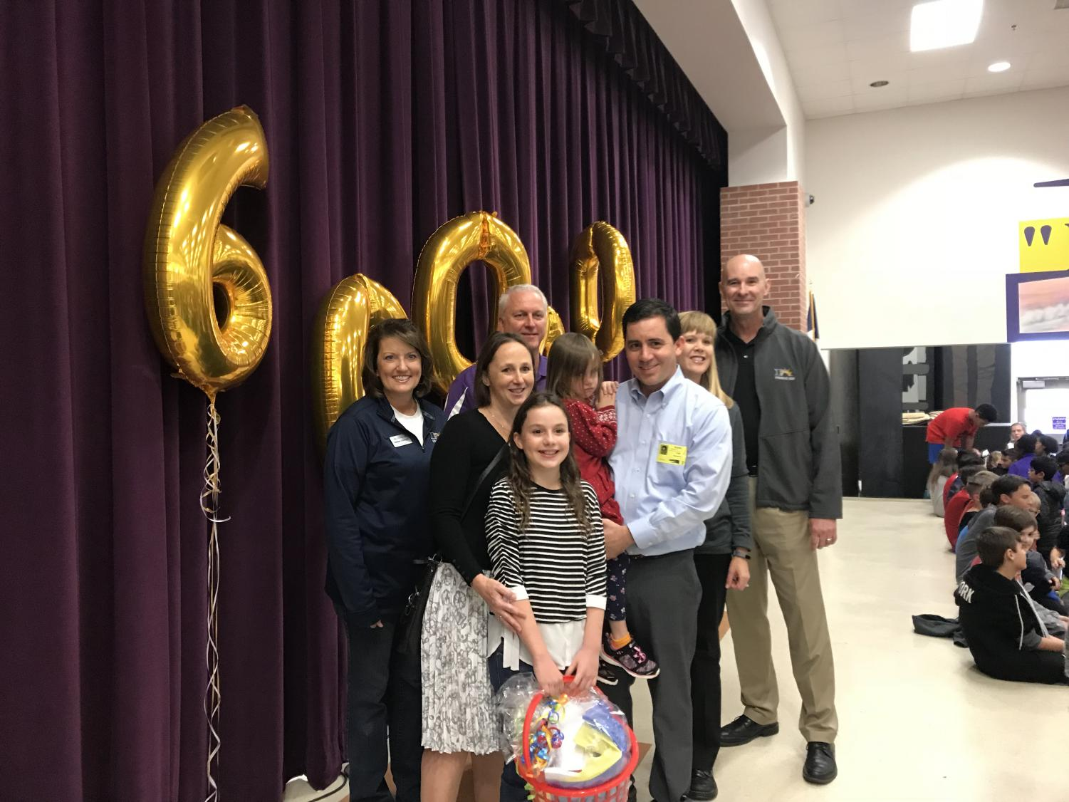 Alanna+Mazeffa+smiles+for+a+picture+alongside+her+parents+and+Superintendent+Dr.+Waldrip+after+receiving+a+gift+basket+during+Tuesday%27s+celebration.