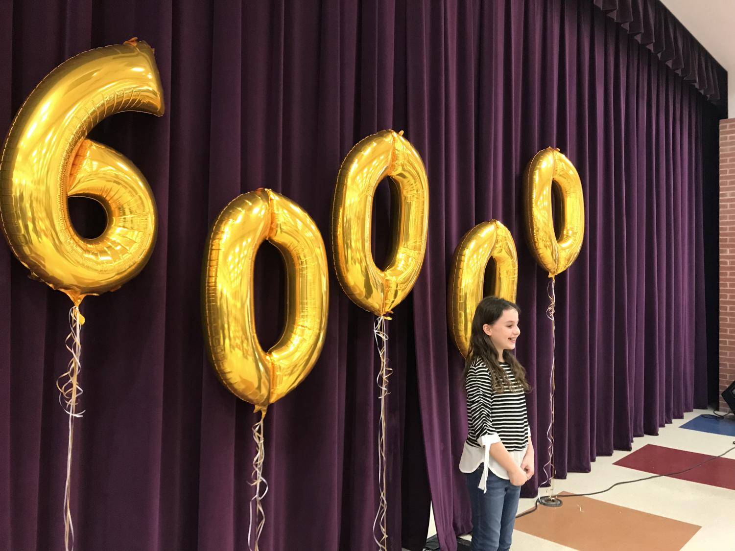 Sixth+grade+student+Alanna+Mazeffa+was+met+with+balloons+and+a+crowd+of+people+cheering+at+her+middle+school%2C+Pioneer+Heritage.+Recognized+as+the+60%2C000th+student+to+enroll+in+Frisco+ISD%2C+Mazeffa+welcomed+her+time+in+the+spotlight+posing+in+front+of+balloons+on+her+campus%27+stage.