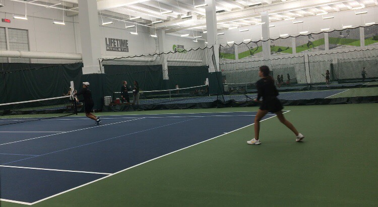 Tennis played against McKinney North in an indoor court at Lifetime Fitness in Plano.