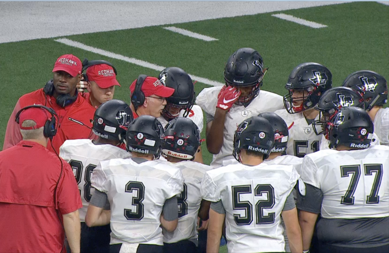 Talking to the offense during a timeout during the 2018 game against Centennial at the Ford Center, former offensive coordinator and new head coach Matt Swinnea hopes the the team improves on last year's winless season. The Redhawks open the 2019 season with a scrimmage against Royse City on Friday.