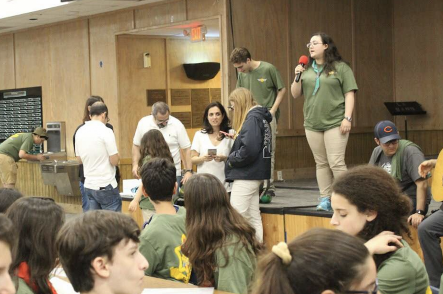 Many+Jewish+students+on+campus+such+as+senior+Yael+Ben+David+pictured+holding+the+microphone+at+are+involved+in+Israeli+Scouts%2C+a+group+that+builds+connections+among+Jewish+youth+in+America.+With+Yom+Kippur+approaching%2C+many+people+practicing+the+faith+are+fasting%2C+for+spiritual+reflection.+