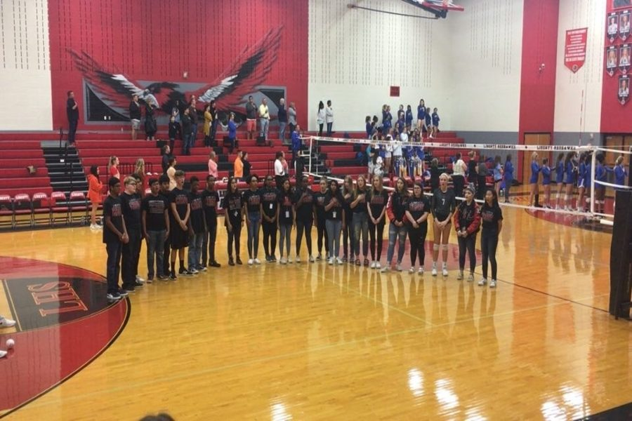 Choir sings national anthem before volleyball game. Among them are sophomore Megan Guidry, juniors Kia Dunlop and Jessie Rho   along with seniors Jessica Gordon and Merlyn George; all five made All-Region Choir.