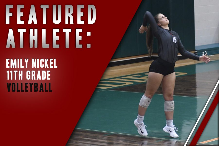 Nickle+is+about+to+serve+the+ball+over+the+net.